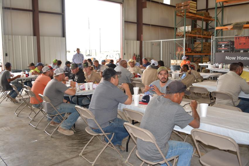 Customers and employees of Bobcat of Midland-Odessa enjoyed brisket and chicken for lunch at the company's grand opening.