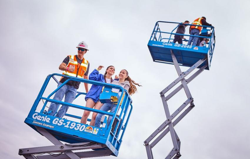 Sunstate Equipment's scissor lift rides were a popular feature at the event.