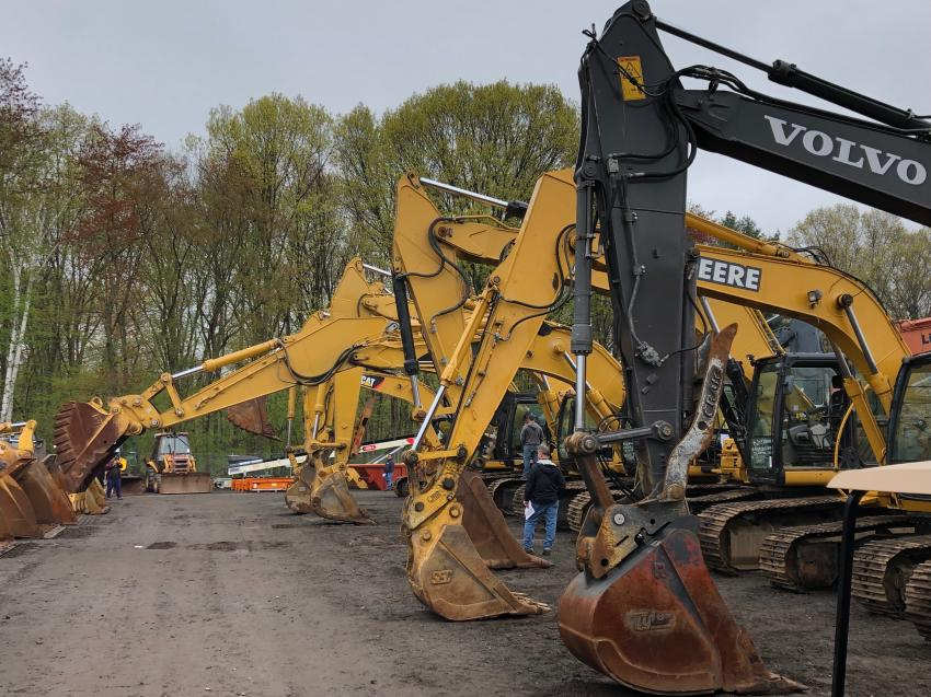 As sale time approaches, excavators are tested and inspected by buyers trying to estimate their value.