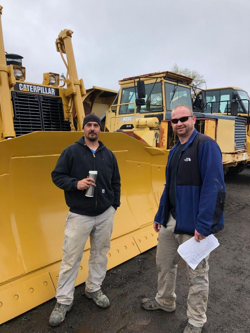 Damir Sullivan (L), Bristol, Conn., and Steven Molaskey, from Terryville, Conn., check out the impressive line of crawler tractors at Sales Auction Company's spring event.