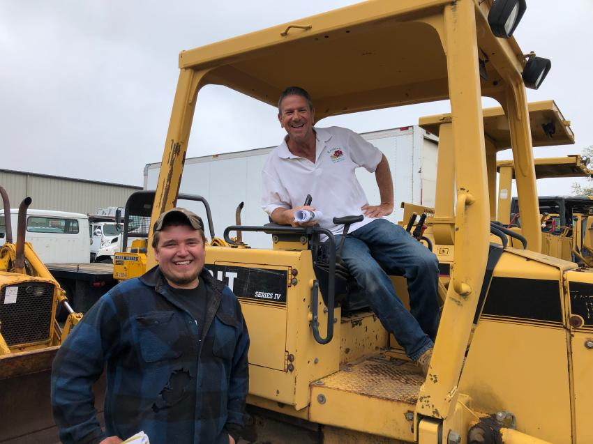 Old friends Nick Zyskowski (L) of Zysk Brothers Landscaping in West Hartford, Conn., and Richie Roulston of Roulston Services in Windsor Locks, Conn., get reacquainted while inspecting this John Deere 450 crawler.