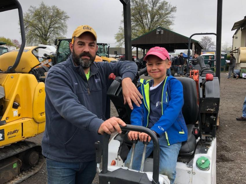 Cale Tallman of Tallman Excavation in Fairfield, Conn., enjoys watching his son, Will, get a little seat time in this Bobcat mini-excavator.