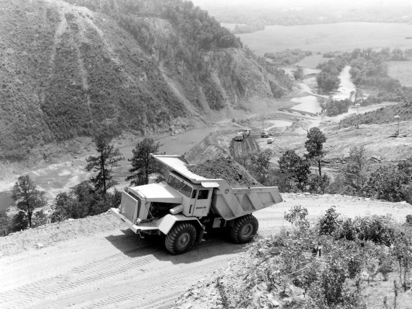 A loaded Euclid R-35 rear dump travels a haul road overlooking the Carter Dam site on May 15, 1965. (HCEA: Euclid Collection photo)
