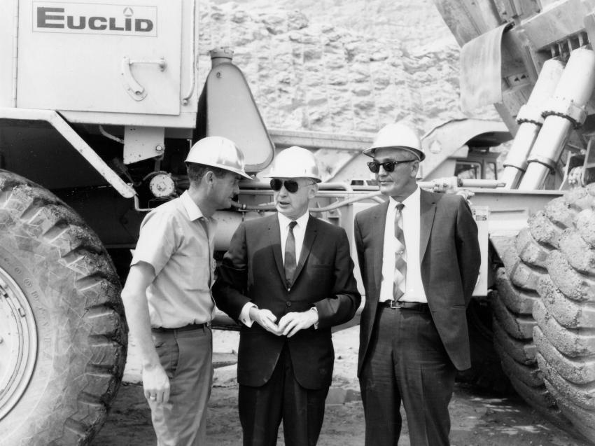 Three unidentified project officials are photographed in front of one of the Euclid R-35 trucks. (HCEA: Euclid Collection photo)