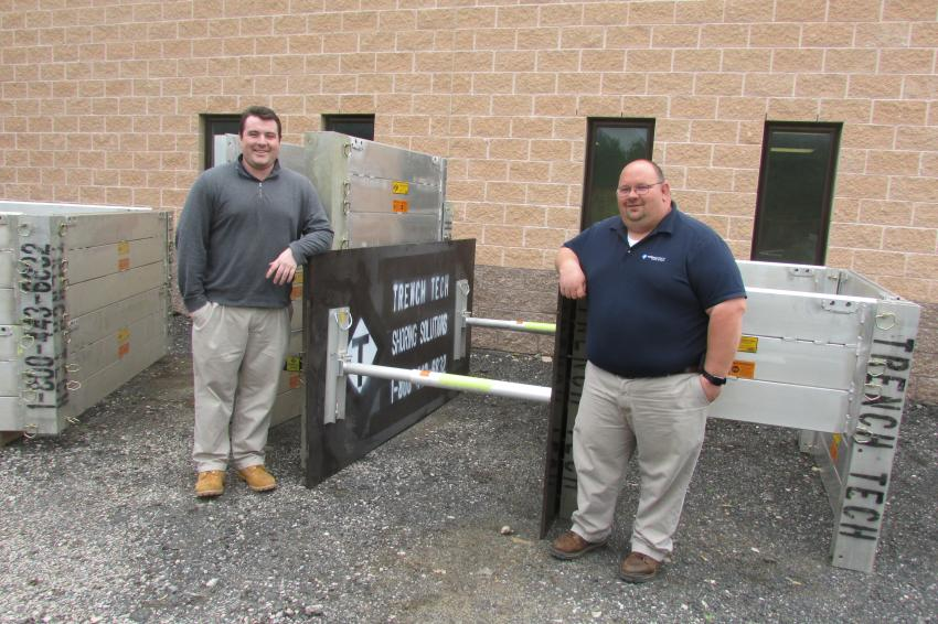 Connor Kerrigan (L), sales representative, and Carl Lamb, both of TrenchTech stand aside a hydraulic shoring system.
