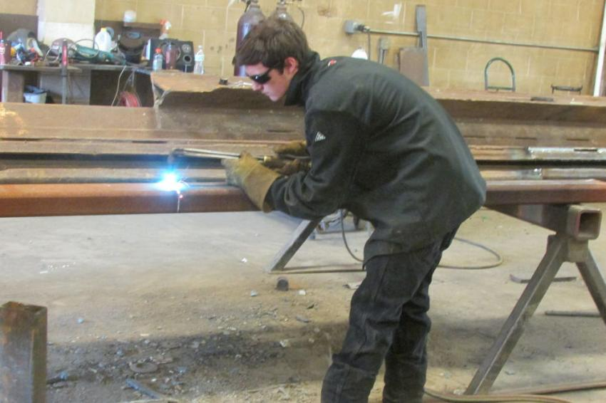 Dominic Napoli of TrenchTech welds a new C-channel on a slide rail corner post.