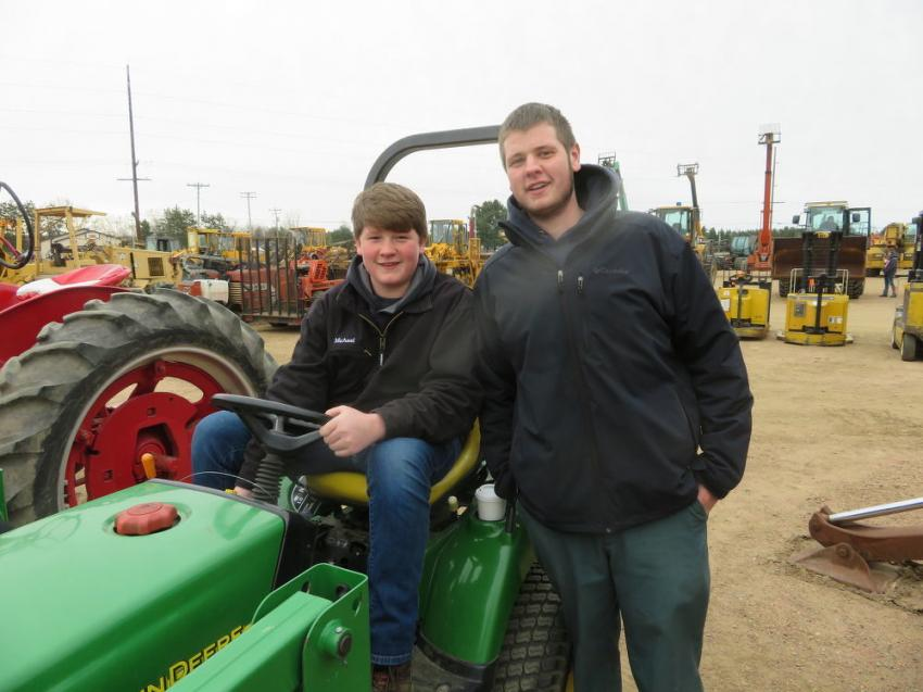 Michael Vruwink (L) and his brother, Justin, both of Vruwink Landscaping, liked a John Deere 2210 tractor.