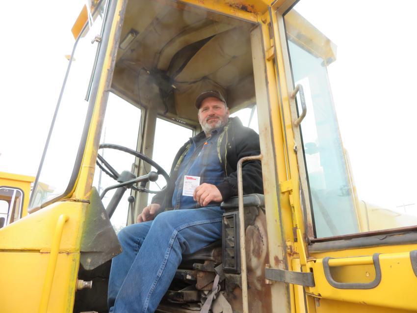Mike Fusak of Fusak Construction gets some stick time in a John Deere 644D.