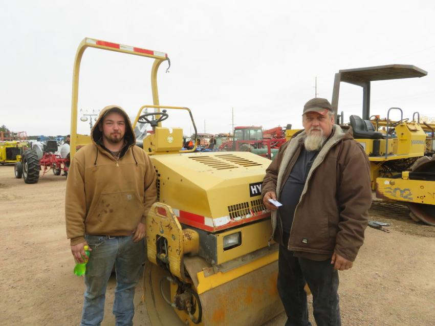 The father-and-son team of Vilas (L) and Norm Wolff of Ringle Ave Enterprise looks over a Hypac C754B double-drum roller.