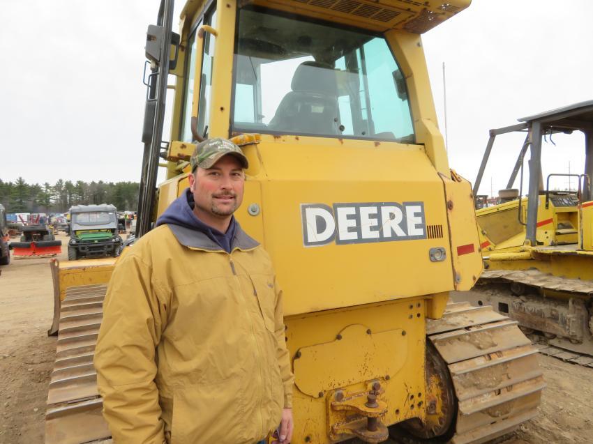 Superior Plumbing's Josh Joslin looks over a John Deere 700H dozer.