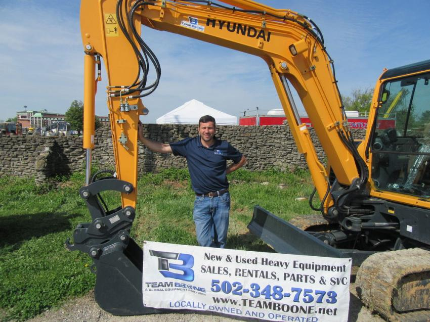 Kyle Greenwell of Team Boone was on hand at the entrance to the auction with an equipment display that featured the dealer's lineup of Hyundai machines.