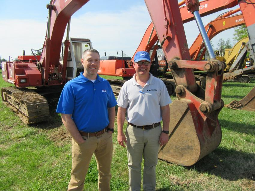 Allied CP District Representative Scott Bauercamper (L) takes in the auction activities with Construction Machinery Company's Jason Faust.