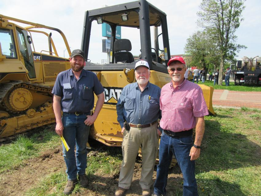 (L-R): Ben Hancock; his father, Judge Jim Hancock; and Dave Bierman of Padgett Crane came from across the river in Indiana, hoping to take home some equipment bargains.