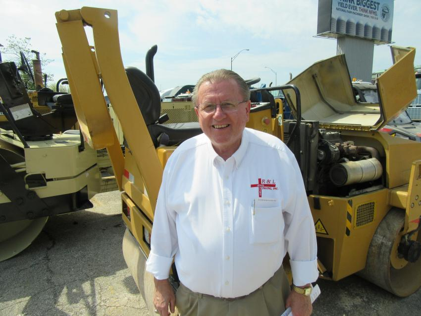 Roger Thornsbury of R & L Paving Inc. looks over the selection of pavers and rollers.
