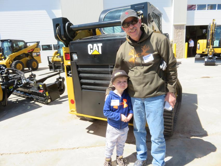 Bill Emery brought his son, Mason, to see all the neat Cat equipment at the open house.