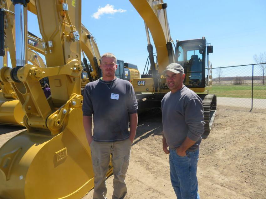 Jerod Pichler (L) and Tim Spaeth of JLP Construction look of the excavator lineup at the open house.