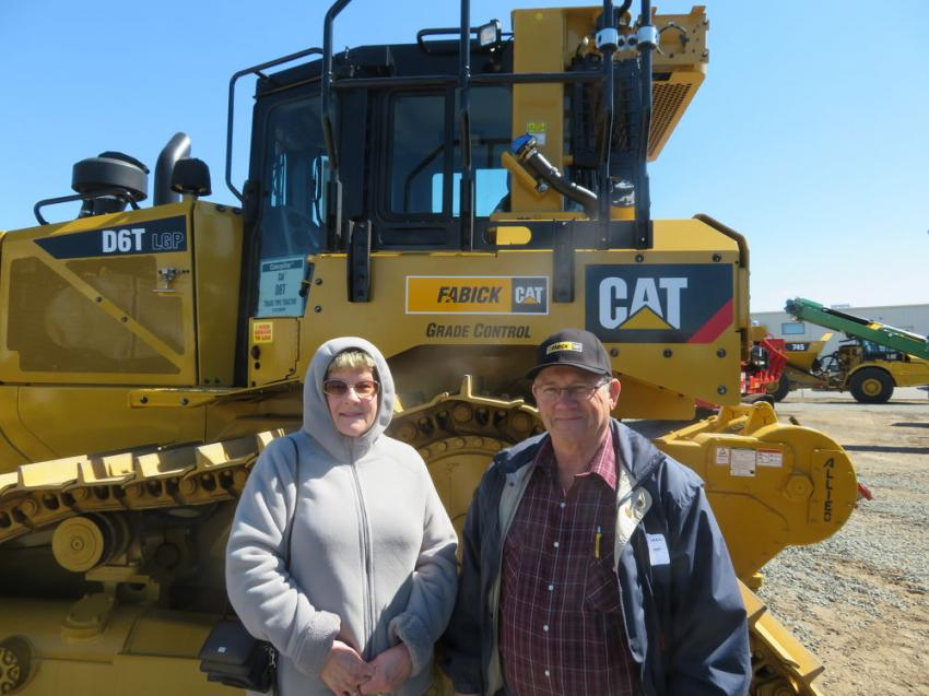 Marilynn and Jerold Auman of J&M Construction stand in front of a new Cat D6T dozer.