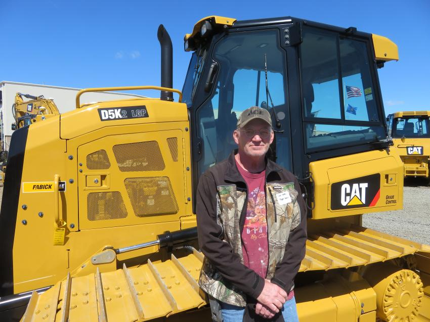 Jan Bohac of Aspen Homes looks over the lineup of Cat dozers at the annual season opener.