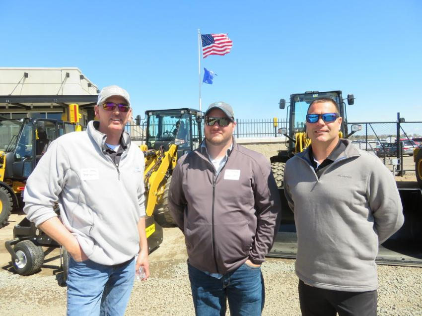 (L-R): Tom Muehlenkamp of Fabick Cat welcomes Greg Johnson and Phil Holloway, both of Smart Sand, to the Fabick Cat Eau Claire, Wis., facility.