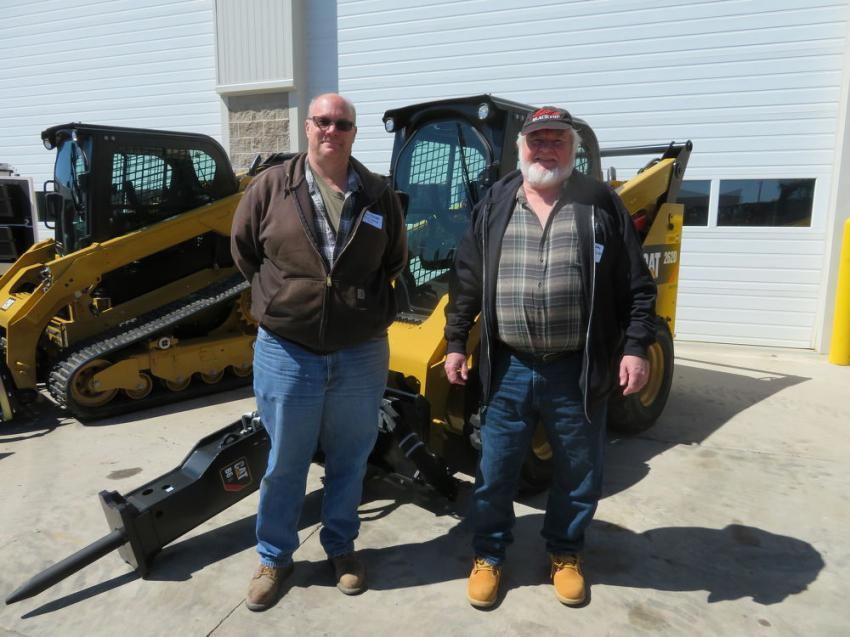 Kurt Kalepp (L), owner of Kalepp Excavating, and Steve Colby of Colby Excavating LLC view the Cat skid steers and attachments.