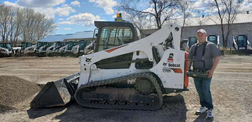 Chad Halverson, service tech at Farm-Rite St. Cloud, demos the popular Bobcat remote control system on a T750.