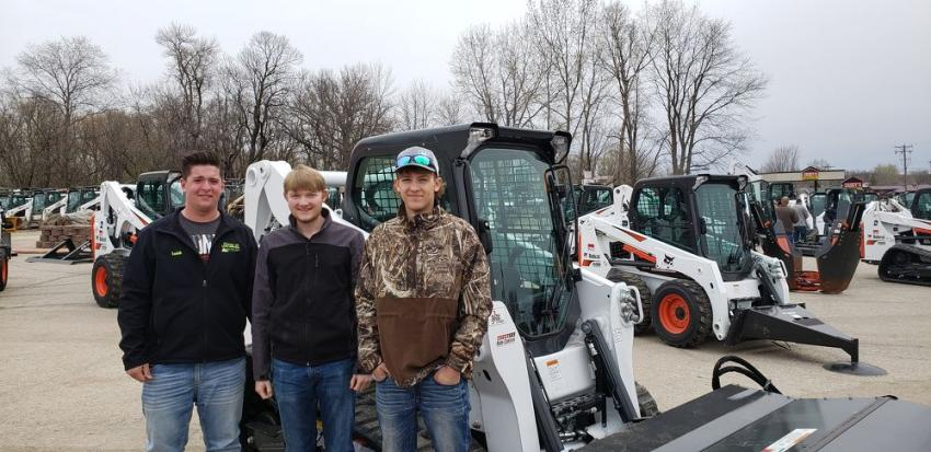 (L-R): The Honey-Do Crew from Honey-Do Landscaping and Lawncare of Glencoe, Minn. — equipment operators Isaiah Streich and Peyton Proehl and equipment manager Adam Garaoutte — check out a Bobcat T650 with sweeper attachment.
