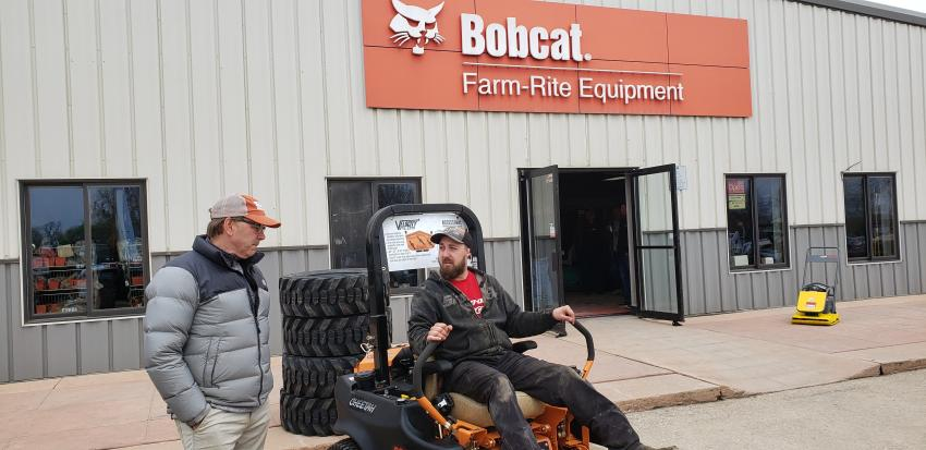 Eric Dickey, Dassel, Minn., takes a test run on a SCAG Chetah 61-in. commercial mower as SCAG Territory Manager Jeff Meyer answers his questions.