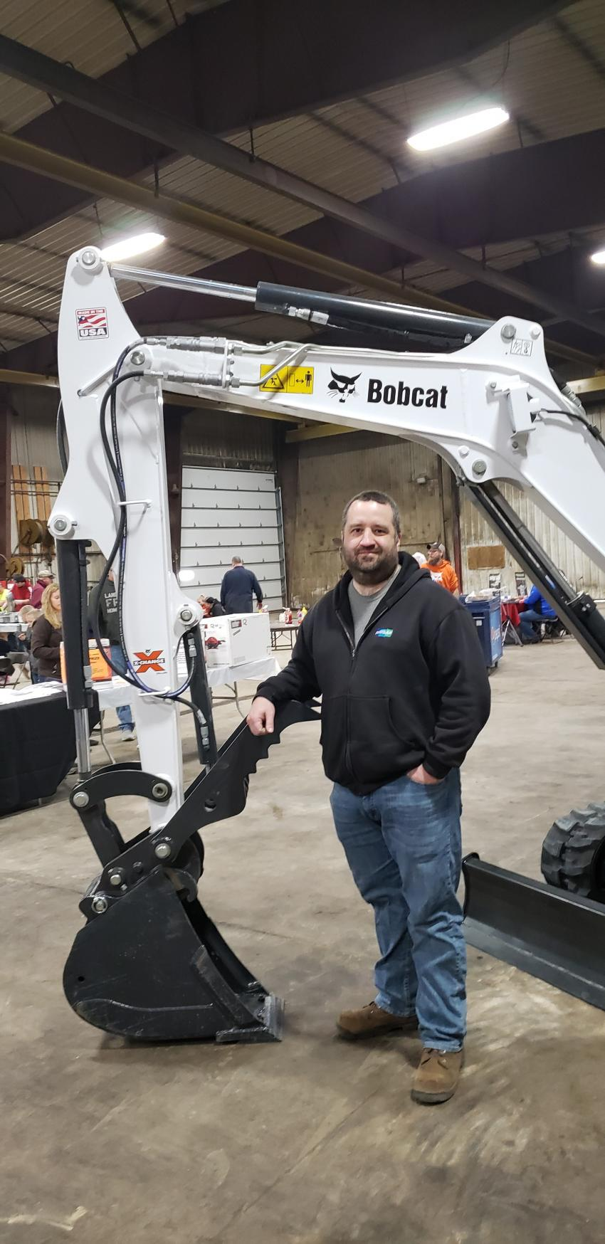 Mike Lougheed, manufacturing engineer at Bobcat's Litchfield, Minn., facility, makes the Bobcat MX Class 4 buckets with thumbs, such as the one shown here on an E35 excavator at the Dassel open house.