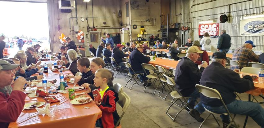The crowd enjoys lunch at the St. Cloud open house.