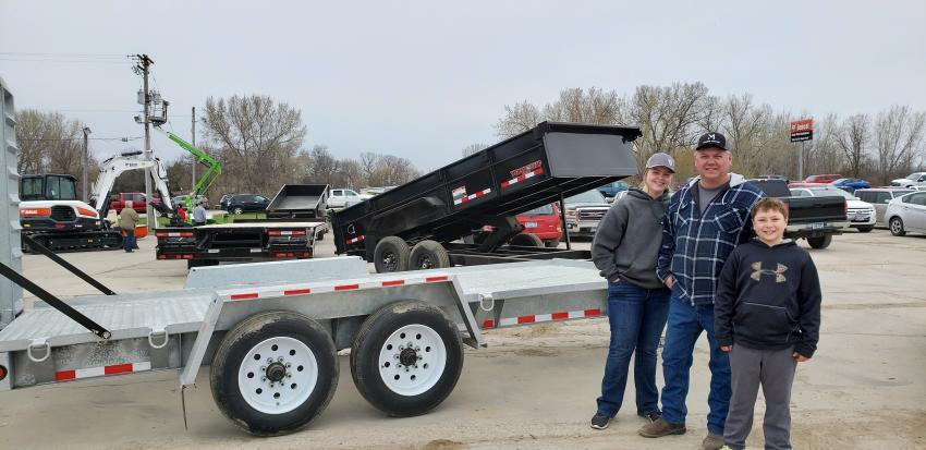 Farm-Rite's Dassel open house is a family event for Towmaster parts manager Ryan Krall (C) and his children, Lydia and Logan, who are taking a look at Towmaster's popular galvanized steel T14-D trailer.