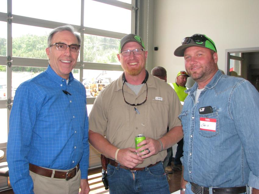 (L-R): Mark Long, owner of Southland Machinery, welcomes customers Heath Seelbinder and Chris Roll of Brisco Construction, Riverside, Ala., to the event.