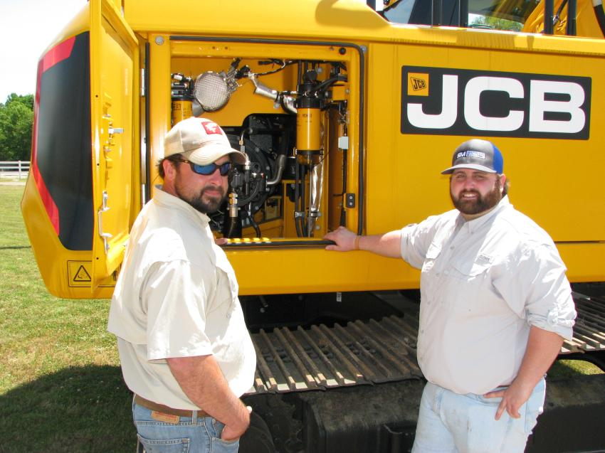 Patrick McAlister (L) of McAlister Grading, Vestavia, Ala., and Connor Smith, sales representative of Southland Machinery, open up a JCB 220X during a demo of the machine.