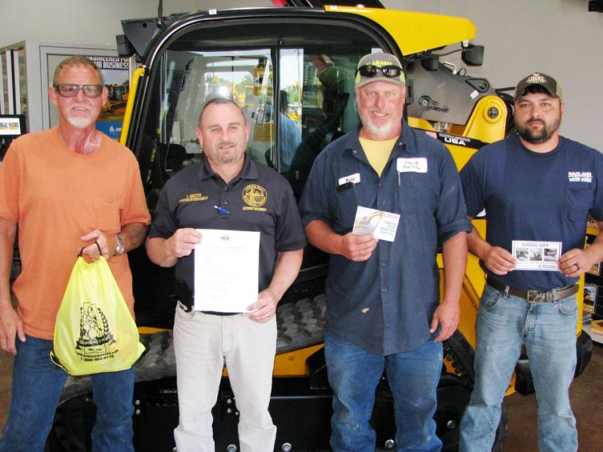 "Some of the big winners of the day included (L-R): Michael Cosby, MC Plumbing, Heflin, Ala., winner of a ""swag bag"" from Bandit; Jason Smith, city of Birmingham (Ala.), four tickets to an upcoming Birmingham Barons baseball game; Pete Tray, city of Pell City, one week free rental of a mini-excavator; and Chris Gardner of Ragland Water Works, a $1,000 off next machine purchase certificate."