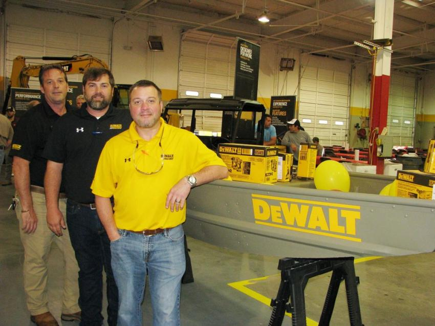 "The grand prize, a Tracker 12W Jon Boat with lots of DeWalt products and Cat ""swag,"" valued at approximately $2,500, was provided by the DeWalt team. (L-R): Scott Killin, Todd Monsour and Howard Lewis."