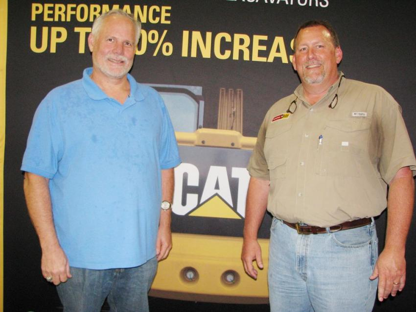 Bryan Tompkins (L), Bomac Electric, Clinton, Miss., stops to chat with his Puckett Rents salesman Todd Driver.