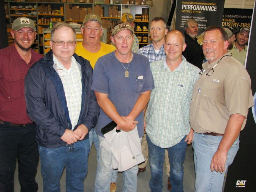 Another big group of rental customers from Fountain Construction, based in Jackson, Miss., turned out for some food and fun. (L-R): Andrew Dennis, Robert Clay, Neal McQueen, Wally Boone, Ray Floyd, Travis Kyzar and Todd Driver of Puckett Rents.