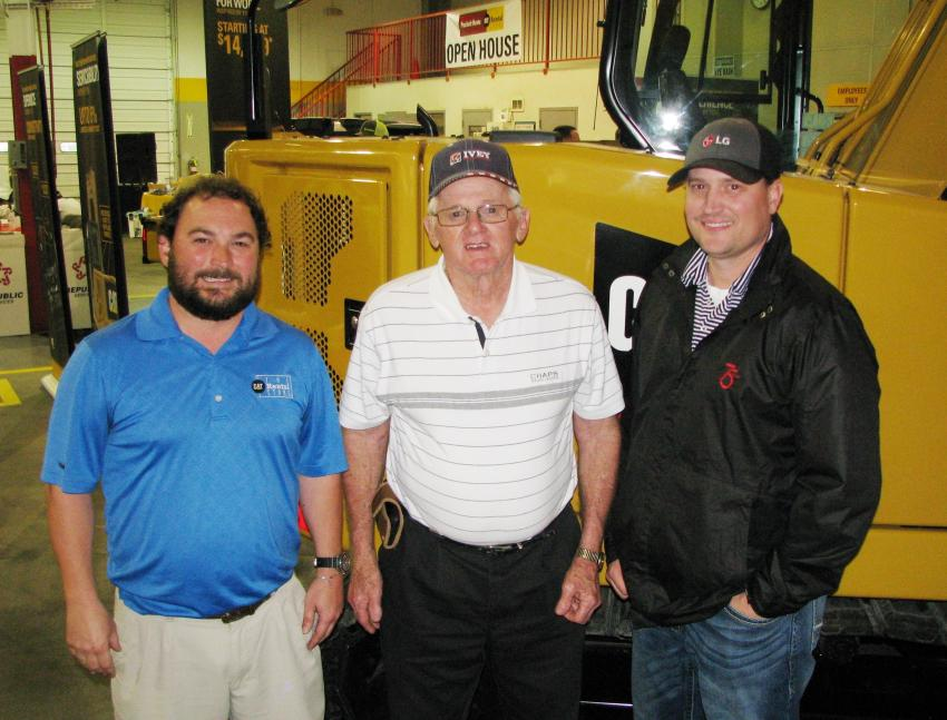 Looking over the Cat machine display inside the building (L-R) are Ryan Newman of Puckett Rents, and J.H. Edwards and Ken Bain of Ivey Mechanical, Kosciusko, Miss.