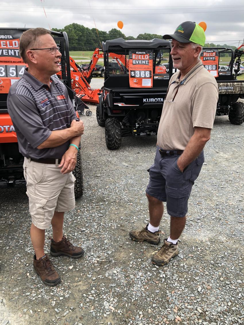 David Brooks (L) welcomes Greg Hargett of Hargett Farms in Mashville, N.C., to the open house.