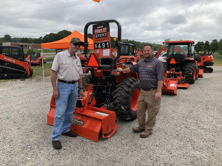 Johnny Thomas (L) of Thomas Contracting in Anson County, N.C., and Derek Brooks go over the Kubota LA525 tractor.