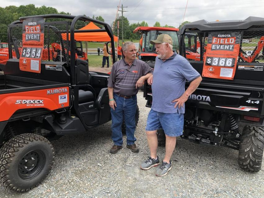 Going over the different options on the Kubota RTV machines are Philip Brooks (L) and Marvin Trull of Boggs Paving in Monroe, N.C.
