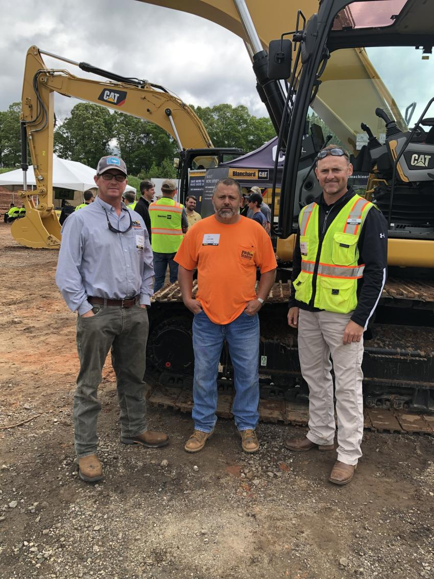 Going over the next generation Cat 330 excavators are Trey Pierce and J.R. Garren (both of PAR Grading & Hauling in Spartanburg, S.C.) and Brian Stellbrink of Caterpillar.