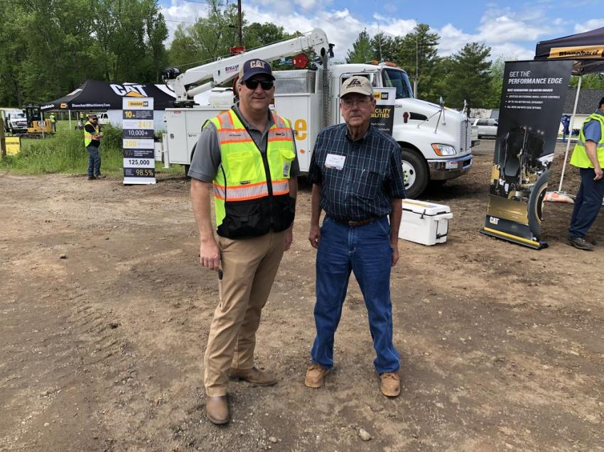Discussing Blanchard Machinery's service capabilities (including 97 field service trucks and more than 200 technicians) are Joel Reynolds (L) of Blanchard Machinery and Eddie Jenkinson of Strange Brothers Grading in Taylors, S.C.
