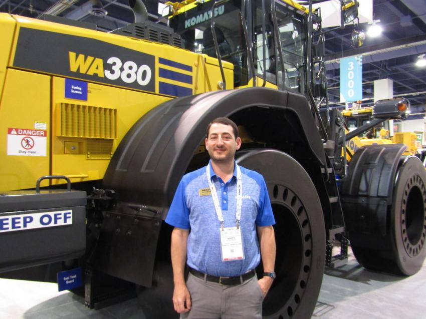 Scott Ruderman, product specialist of Komatsu America Corporation, displays the WA380 wheel loader, fully geared up for the waste industry at 191 hp and 52,000 lbs.