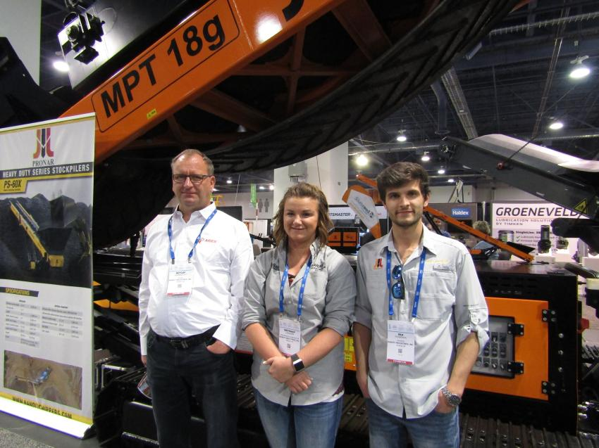 Bandit is taking stacking material to new heights with the PS-60X mobile stacking conveyor. The PS-60X can stack material as high as 28 ft. and features a throughput of 500 tons per hour, depending on the material. Posing with the PS-60X are (L-R) Detlef Harbrecht, Bethany Lenahan and Rui Ferreira, all of Bandit Industries.