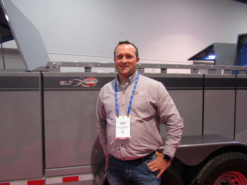 Jeremy Scott of Thunder Creek Equipment exhibits the company's redesigned service and lube trailer.