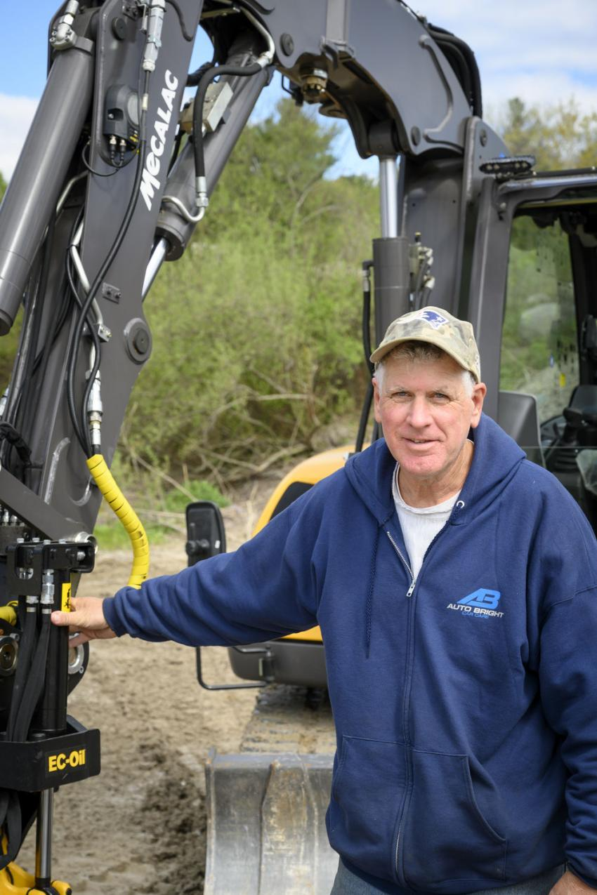 Dave Colageo of Colageo Construction in Stoughton, Mass., in front of a Mecalac 8MCR excavator with an Engcon EC-Oil attachment.