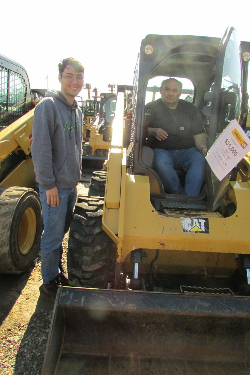 Tyler (L) and Tom Zafis, both of Zaffs Construction, Port Murray, N.J., were very interested in this Cat 262D skid steer.