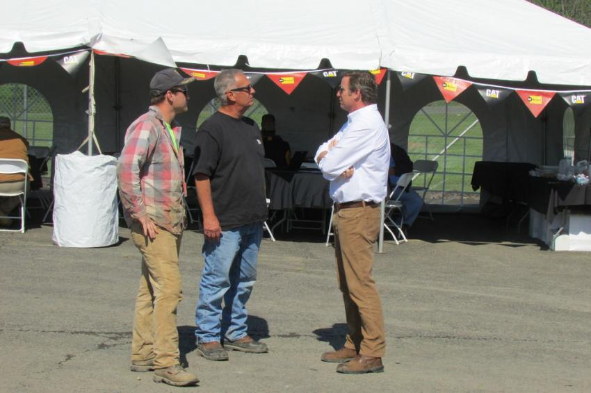 Ryan Foley (R), president of Foley Inc., speaks with customers during the One-Day Sales Event in Bensalem, Pa.