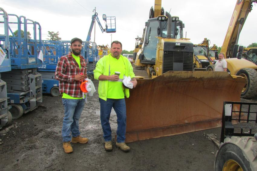 Manny Oliveira (L) and Tom Lee, owner, both of Tom's Backhoe and Excavation Services, Cinnaminson, N.J., are interested in this Cat D6K and other equipment at the Foley Inc. One-Day Sales Event.