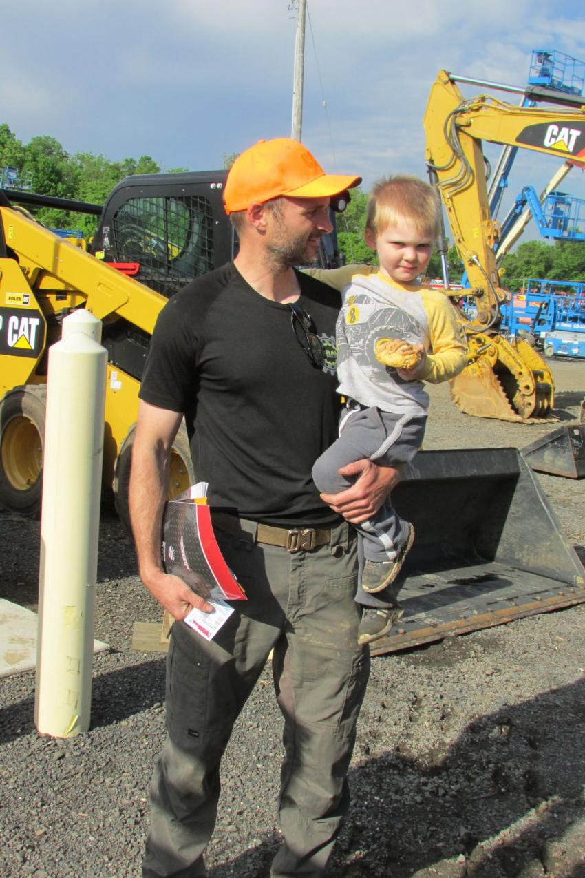 Rich Brauer of R.K. Brauer Contracting Services, Perkasie, Pa., and his son, Bruce, are having a great time looking at the big Cat iron during the One-Day Sales Event.
